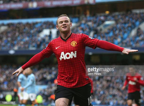 Wayne Rooney of Manchester United celebrates scoring their second goal during the Barclays Premier League match between Manchester City and...