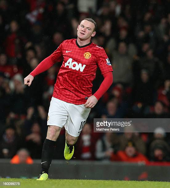 Wayne Rooney of Manchester United celebrates scoring their second goal during the FA Cup Fourth Round match between Manchester United and Fulham at...