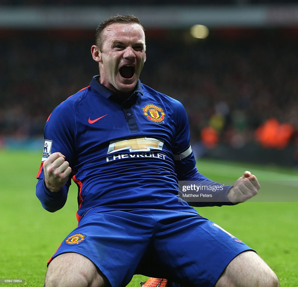 Wayne Rooney of Manchester United celebrates scoring their second goal during the Barclays Premier League match between Arsenal and Manchester United at Emirates Stadium on November 22, 2014 in London, England.