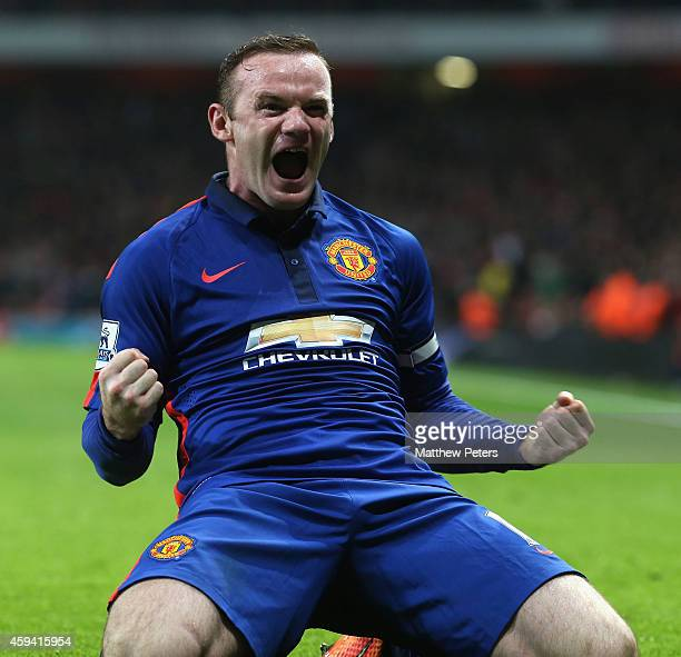 Wayne Rooney of Manchester United celebrates scoring their second goal during the Barclays Premier League match between Arsenal and Manchester United...
