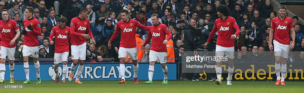 Wayne Rooney (C) of Manchester United celebrates scoring their second goal during the Barclays Premier League match between West Bromwich Albion and Manchester United at The Hawthorns on March 8, 2014 in West Bromwich, England.