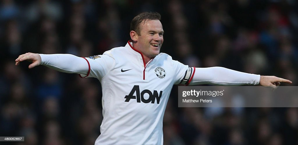 Wayne Rooney of Manchester United celebrates scoring their second goal during the Barclays Premier League match between West Ham United and Manchester United at Boleyn Ground on March 22, 2014 in London, England.