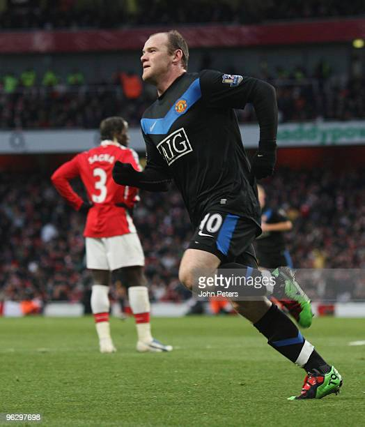 Wayne Rooney of Manchester United celebrates scoring their second goal during the FA Barclays Premier League match between Arsenal and Manchester...