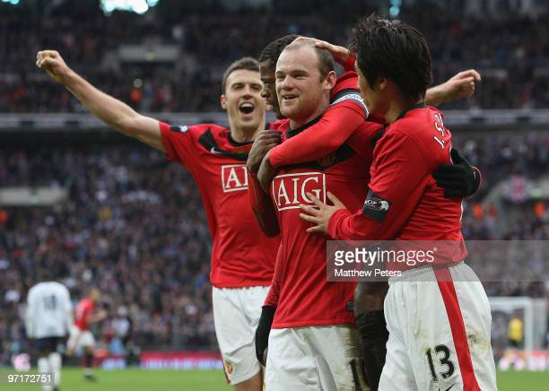 Wayne Rooney of Manchester United celebrates scoring their second goal during the Carling Cup Final match between Aston Villa and Manchester United...