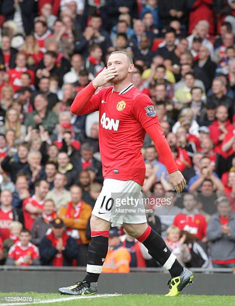 Wayne Rooney of Manchester United celebrates scoring their seventh goal during the Barclays Premier League match between Manchester United and...
