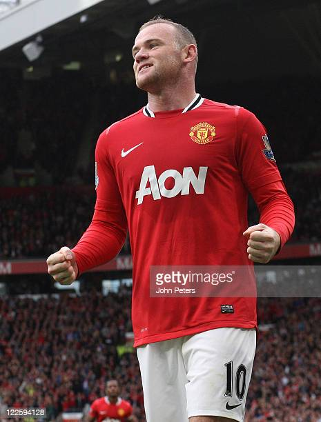 Wayne Rooney of Manchester United celebrates scoring their seventh goal during the Barclays Premier League match betwen Manchester United and Arsenal...