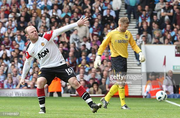 Wayne Rooney of Manchester United celebrates scoring their third goal during the Barclays Premier League match between West Ham United and Manchester...