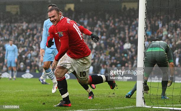Wayne Rooney of Manchester United celebrates scoring their third goal during the FA Cup Third Round match between Manchester City and Manchester...