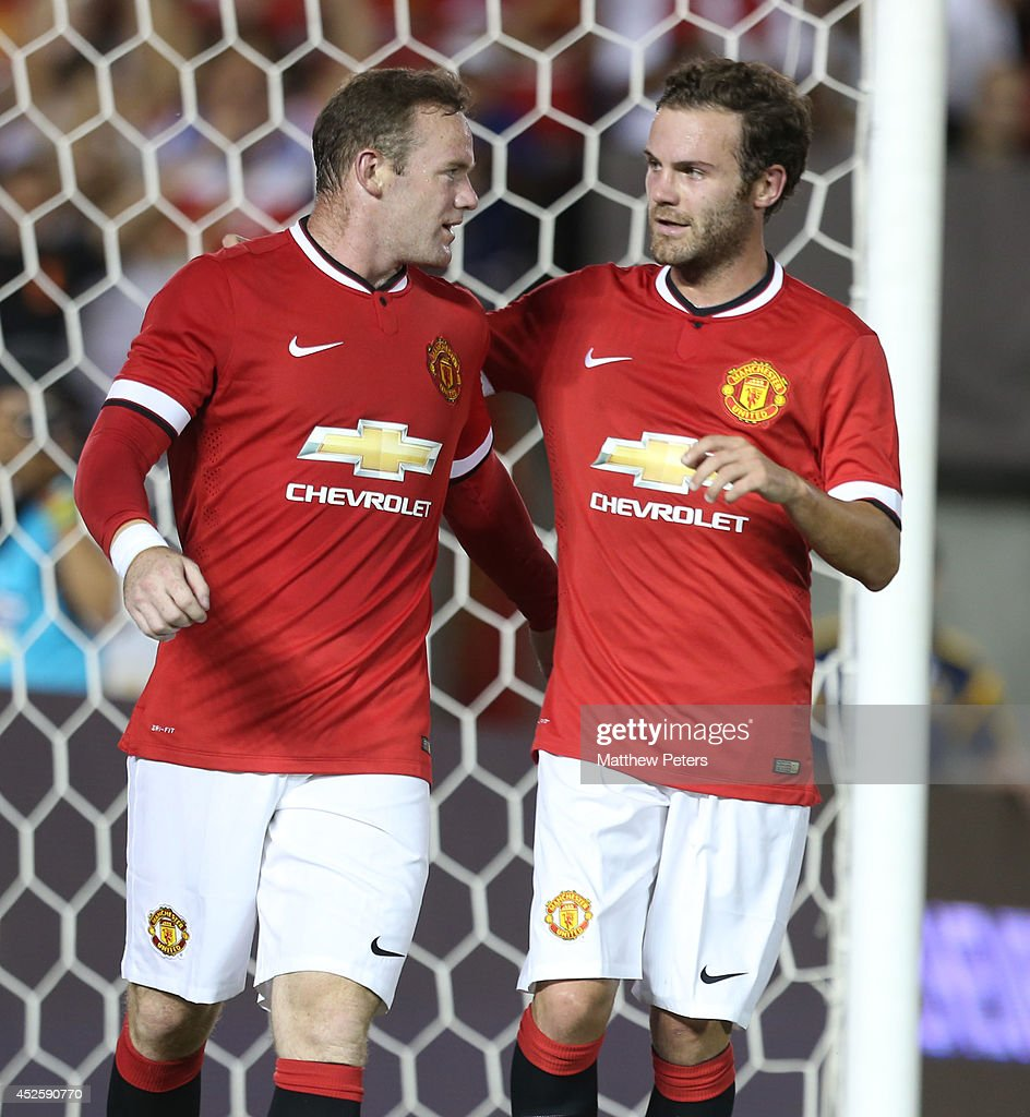 Wayne Rooney of Manchester United celebrates scoring their third goal during the pre-season friendly match between Los Angeles Galaxy and Manchester United at Rose Bowl on July 23, 2014 in Pasadena, California.