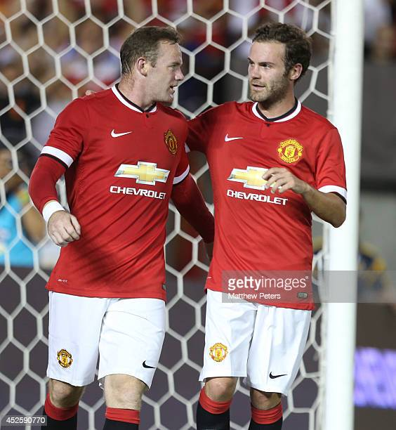 Wayne Rooney of Manchester United celebrates scoring their third goal during the preseason friendly match between Los Angeles Galaxy and Manchester...