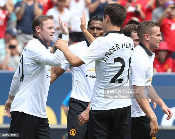 Wayne Rooney of Manchester United celebrates scoring their third goal during the preseason friendly match between Manchester United and AS Roma at...