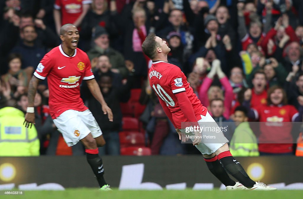 Wayne Rooney of Manchester United celebrates scoring their third goal during the Barclays Premier League match between Manchester United and Tottenham Hotspur at Old Trafford on March 15, 2015 in Manchester, England.
