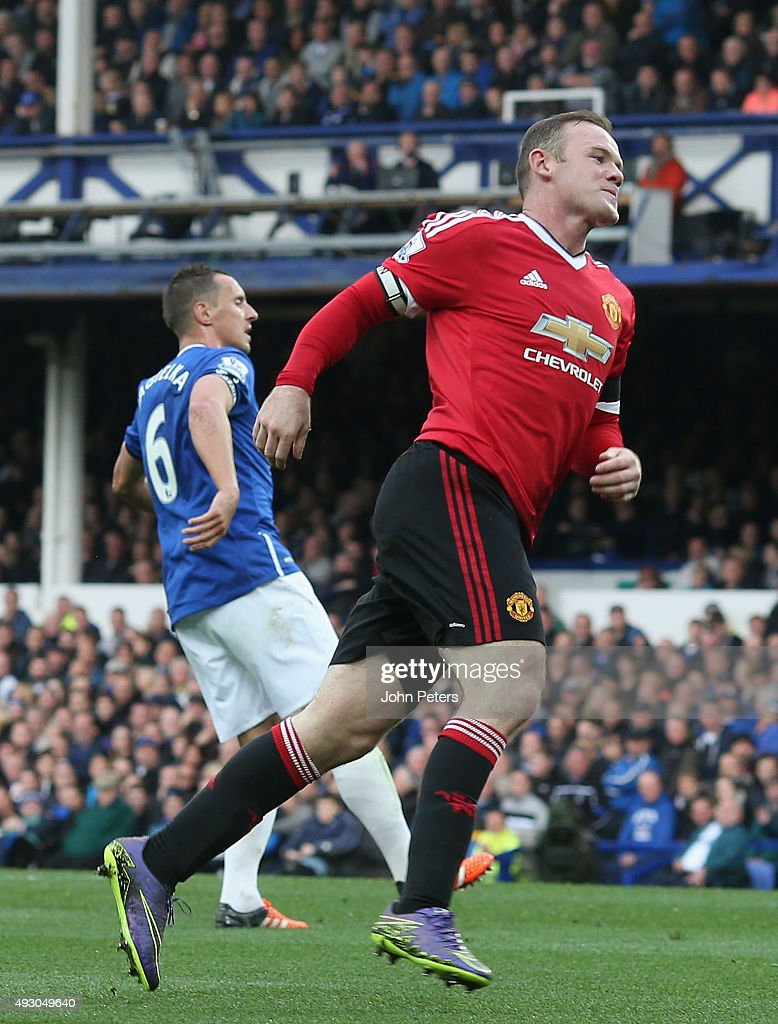 Wayne Rooney of Manchester United celebrates scoring their third goal during the Barclays Premier League match between Everton and Manchester United at Goodison Park on October 17, 2015 in Liverpool, England.