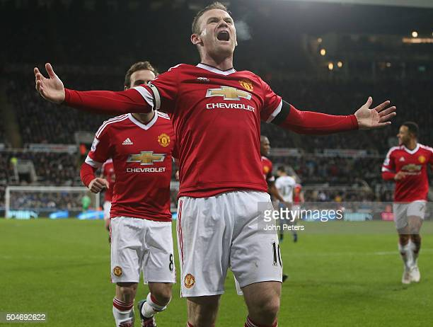 Wayne Rooney of Manchester United celebrates scoring their third goal during the Barclays Premier League match between Newcastle United and...