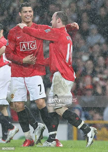 Wayne Rooney of Manchester United celebrates scoring their third goal during the Barclays FA Premier League match between Manchester United and Aston...