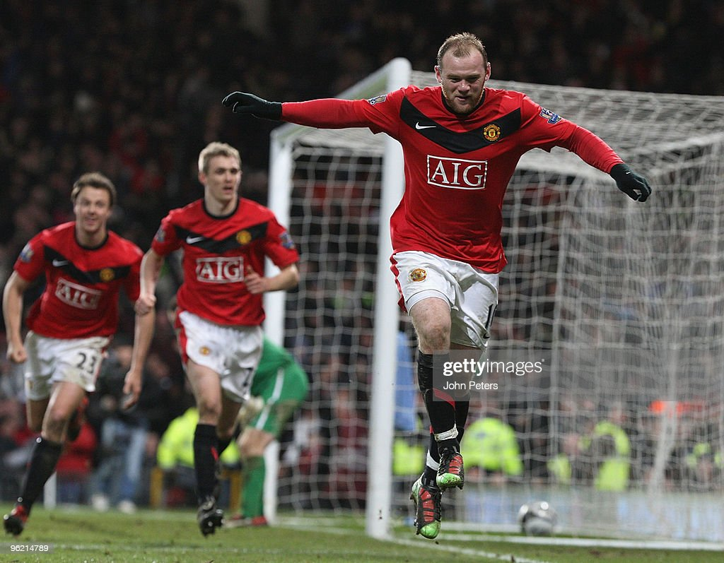 Wayne Rooney of Manchester United celebrates scoring their third goal during the Carling Cup Semi-Final Second Leg match between Manchester United and Manchester City at Old Trafford on January 27 2010 in Manchester, England.