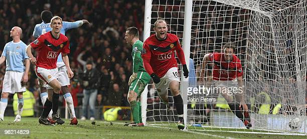 Wayne Rooney of Manchester United celebrates scoring their third goal during the Carling Cup SemiFinal Second Leg match between Manchester United and...
