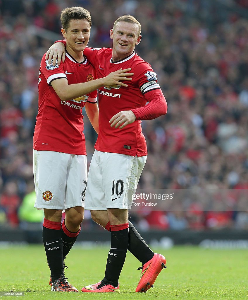 Wayne Rooney of Manchester United celebrates scoring their third goalduring the Barclays Premier League match between Manchester United and Queens Park Rangers at Old Trafford on September 14, 2014 in Manchester, England.