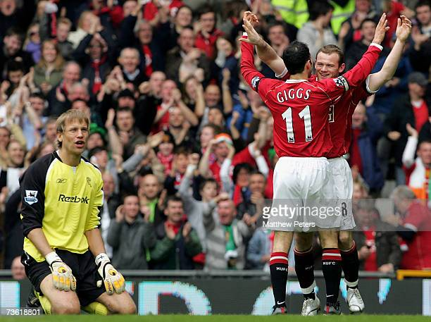 Wayne Rooney of Manchester United celebrates scoring United's second goal during the Barclays Premiership match between Manchester United and Bolton...
