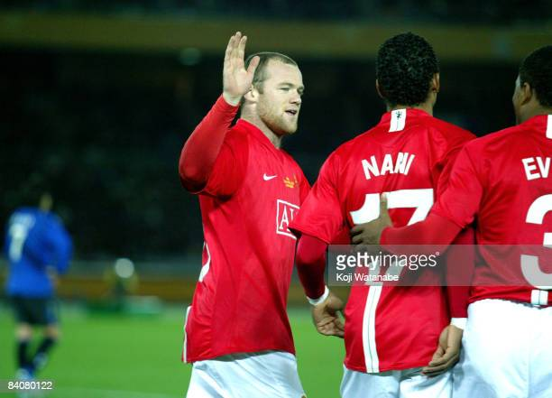 Wayne Rooney of Manchester United celebrates the fifth goal during the FIFA Club World Cup Japan 2008 semi final match between Gamba Osaka and...