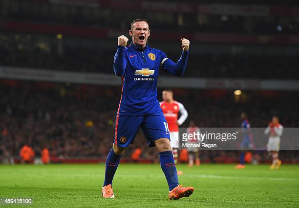 Wayne Rooney of Manchester United celebrates the own goal scored by Kieran Gibbs of Arsenal during the Barclays Premier League match between Arsenal...