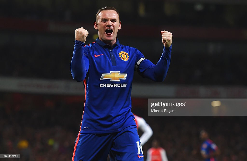 Wayne Rooney of Manchester United celebrates the own goal scored by Kieran Gibbs of Arsenal during the Barclays Premier League match between Arsenal and Manchester United at Emirates Stadium on November 22, 2014 in London, England.