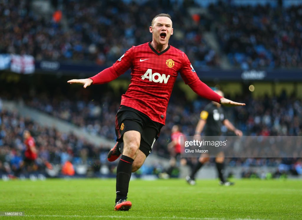 Wayne Rooney of Manchester United celebrates the winning goal during the Barclays Premier League match between Manchester City and Manchester United at the Etihad Stadium on December 9, 2012 in Manchester, England.