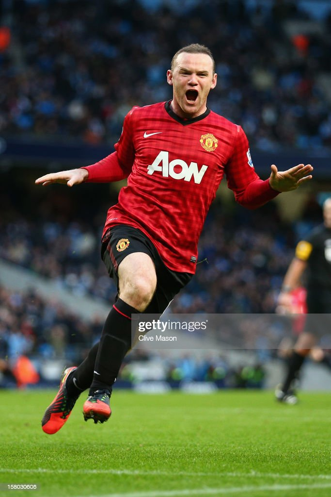 Wayne Rooney of Manchester United celebrates the winning goal during the Barclays Premier League match between Manchester City and Manchester United at Etihad Stadium on December 9, 2012 in Manchester, England.