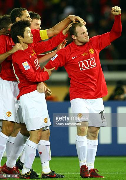 Wayne Rooney of Manchester United celebrates their first goal with teammates during the FIFA Club World Cup Japan 2008 final match between Manchester...