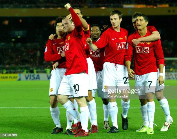 Wayne Rooney of Manchester United celebrates their first goal with teammatesduring the FIFA Club World Cup Final match between Manchester United and...