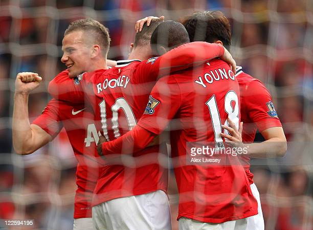 Wayne Rooney of Manchester United celebrates Tom Cleverley and Ashley Young after scoring his third goal from the penalty spot during the Barclays...