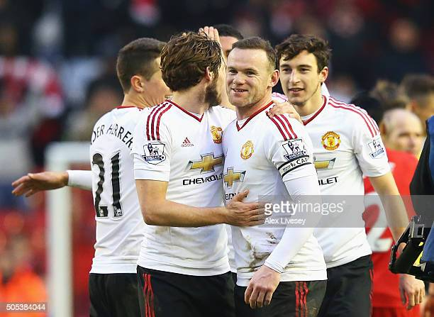 Wayne Rooney of Manchester United celebrates victory with Daley Blind after the Barclays Premier League match between Liverpool and Manchester United...