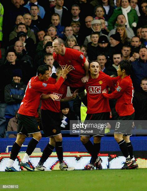 Wayne Rooney of Manchester United celebrates with goal scorer Darren Fletcher during the Barclays Premier League match between Everton and Manchester...