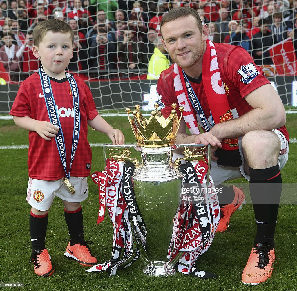 Wayne Rooney of Manchester United celebrates with his son Kai and the Premier League trophy after the Barclays Premier League match between Manchester United and Swansea at Old Trafford on May 12, 2013 in Manchester, England.
