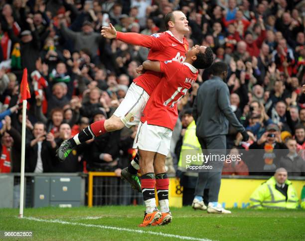 Wayne Rooney of Manchester United celebrates with his team mate Nani after scoring a goal during the Barclays Premier League match between Manchester...