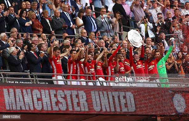 Wayne Rooney of Manchester United celebrates with his team mates after he lifts the Community Shield during The FA Community Shield match between...