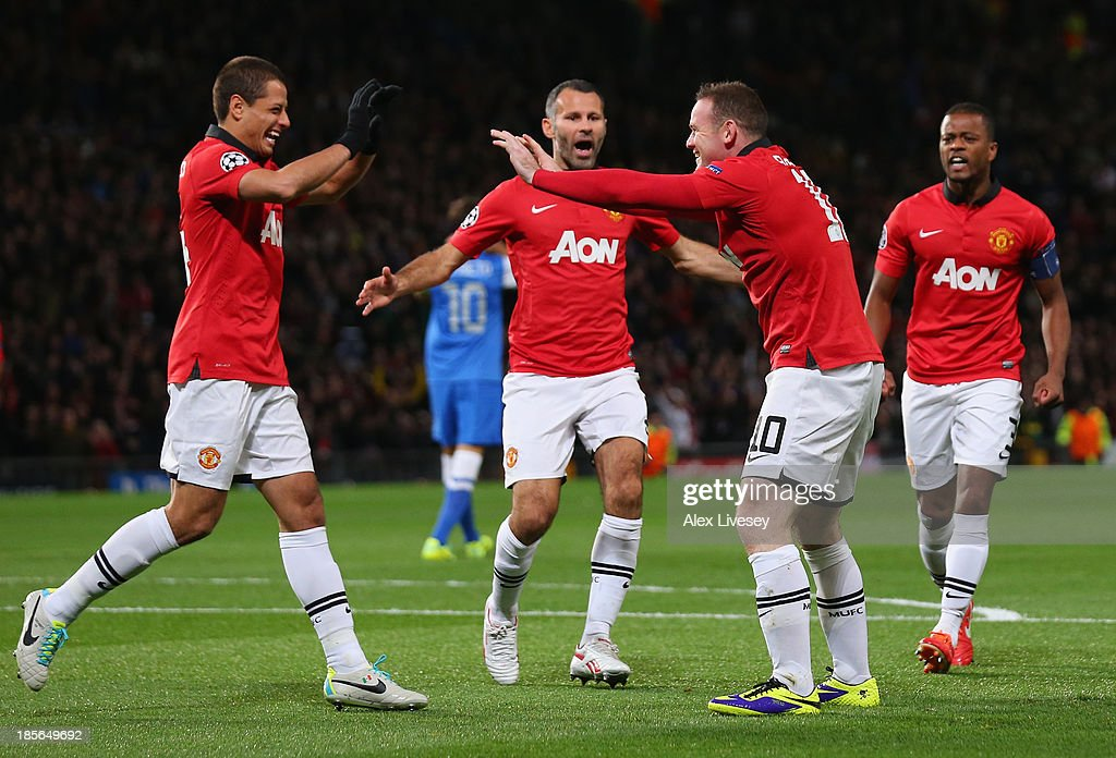 Wayne Rooney of Manchester United celebrates with his team-mates after Inigo Martinez of Real Sociedad scored an own goal to make the score 1-0 during the UEFA Champions League Group A match between Manchester United and Real Sociedad at Old Trafford on October 23, 2013 in Manchester, England.