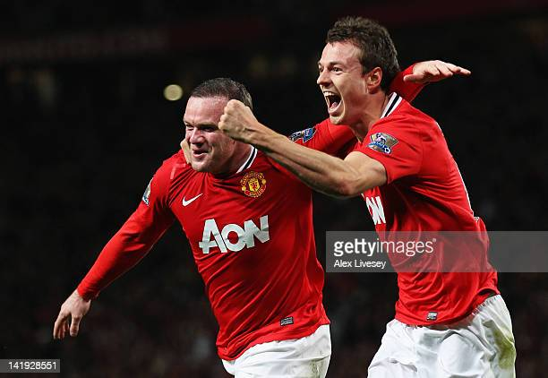 Wayne Rooney of Manchester United celebrates with Jonny Evans as he scores their first goal during the Barclays Premier League match between...