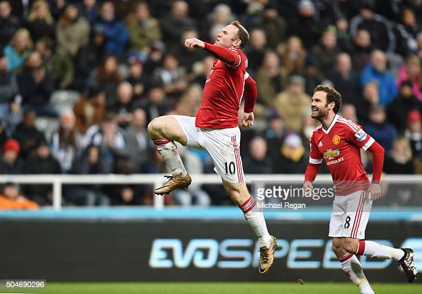 Wayne Rooney of Manchester United celebrates with Juan Mata as he scores their third goal during the Barclays Premier League match between Newcastle...