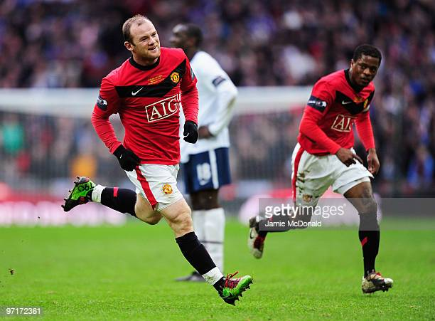 Wayne Rooney of Manchester United celebrates with Patrice Evra as he scores their second goal during the Carling Cup Final between Aston Villa and...