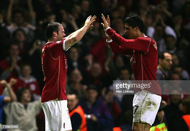 Wayne Rooney of Manchester United celebrates with team mate Cristiano Ronaldo after scoring his team's third goal during the UEFA Champions League...