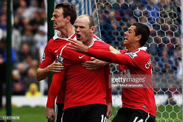Wayne Rooney of Manchester United celebrates with team mates after scoring a penalty during the Barclays Premier League match between Blackburn...
