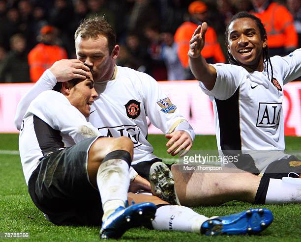Wayne Rooney of Manchester United celebrates with team mates Cristiano Ronaldo and Anderson after scoring the second goal of the game during the FA...