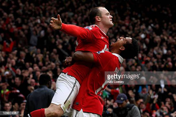 Wayne Rooney of Manchester United celebrates with teammate Nani after he scores a goal from an overhead kick during the Barclays Premier League match...