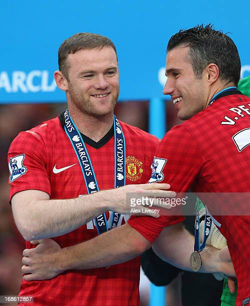 Wayne Rooney of Manchester United celebrates with teammate Robin van Persie following the Barclays Premier League match between Manchester United and...