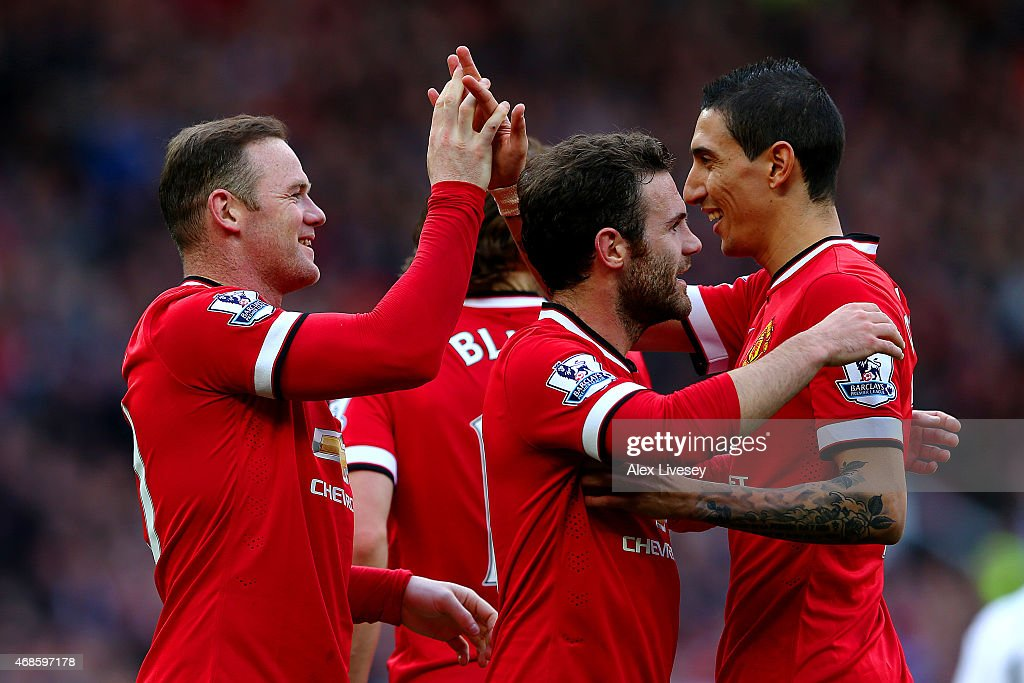 Wayne Rooney of Manchester United celebrates with team-mates after scoring his team's second goal during the Barclays Premier League match between Manchester United and Aston Villa at Old Trafford on April 4, 2015 in Manchester, England.