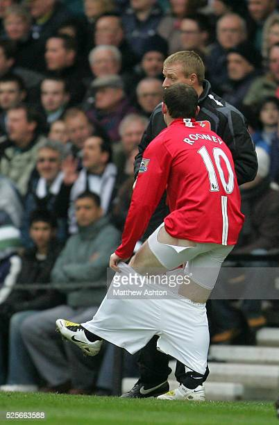 Wayne Rooney of Manchester United changes his shorts during the game