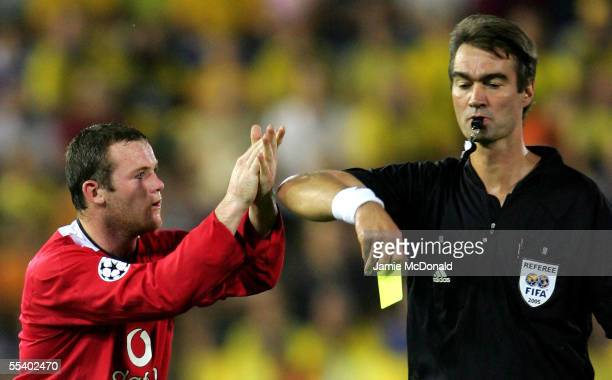 Wayne Rooney of Manchester United claps referee Kim Milton Nielson and is sent off the field of play during the UEFA Champions League Group D match...