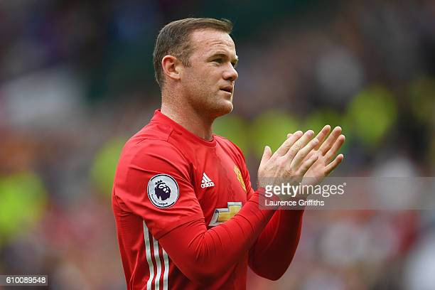 Wayne Rooney of Manchester United claps the fans after the final whistlle during the Premier League match between Manchester United and Leicester...