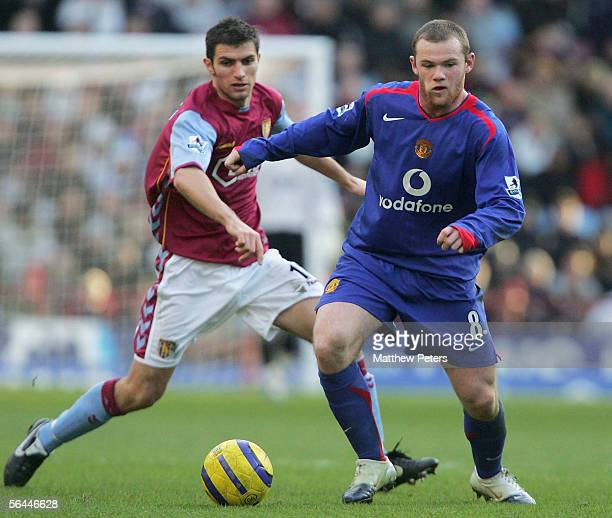 Wayne Rooney of Manchester United clashes with Aaron Hughes of Aston Villa during the Barclays Premiership match between Aston Villa and Manchester...